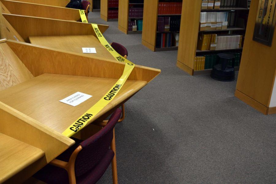 Caution tape warns students to stay away from seats on the third hall of the Thompson Library