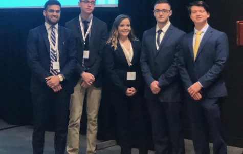 FMA members stand on stage moments after their presentation.