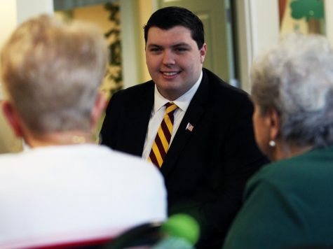 Matthew Smith speaks with residents of Genesee county