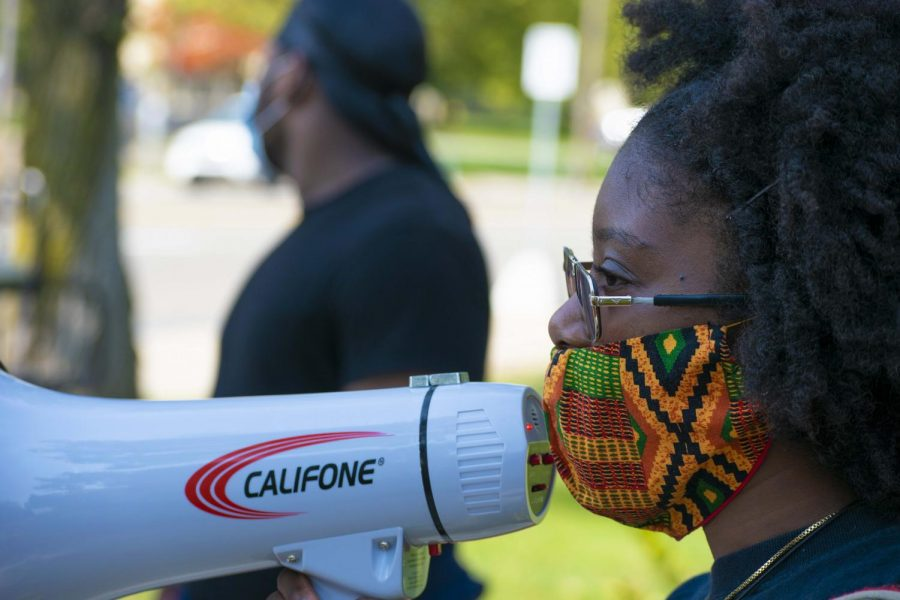 Ashley McIntosh leads on members of the BLM march.