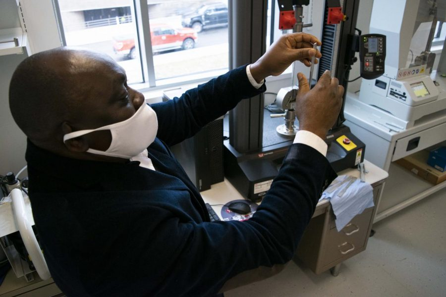 Dr. Lanre Aluko, Associate Professor of Mechanical Engineering, Associate Chair of Engineering, explains how the tensile strength of different metals works inside the Solid Mechanics and Materials Lab.